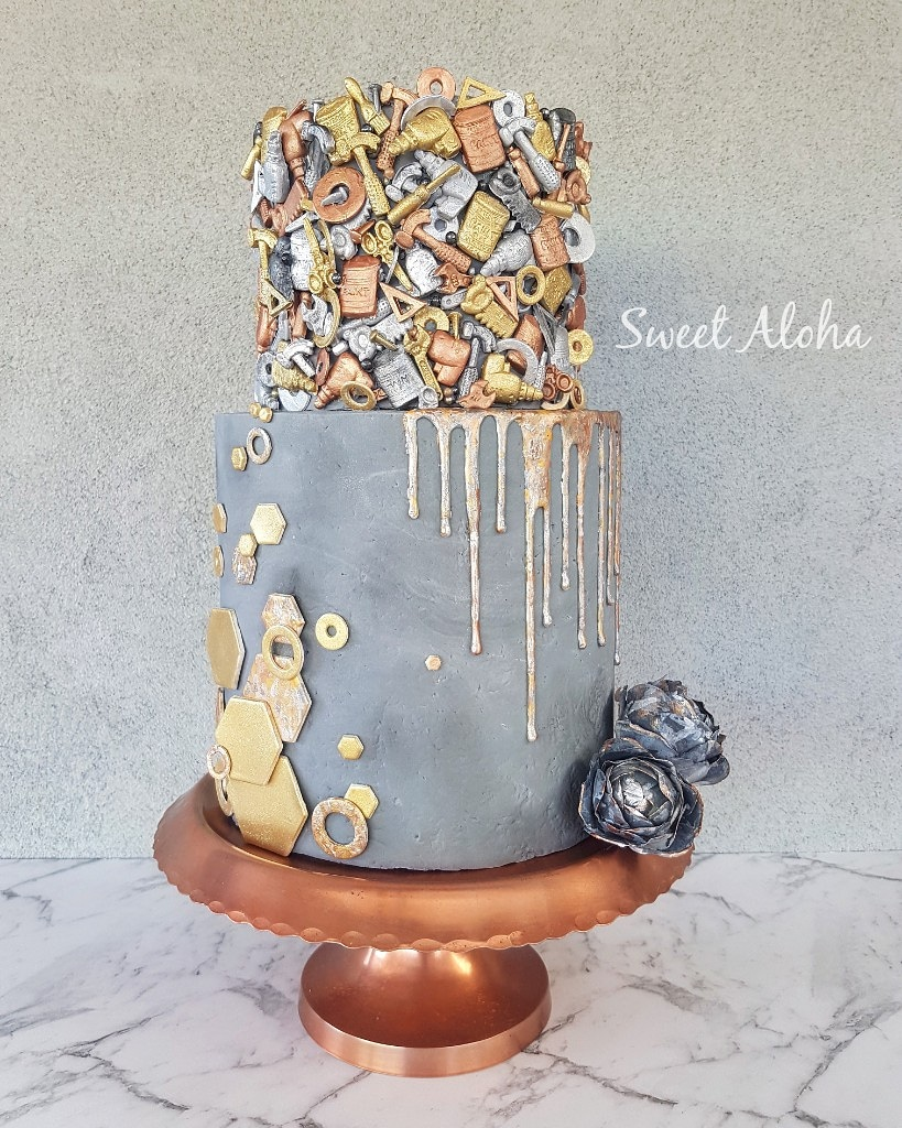 Gray and copper cake with intricate steampunk detailing