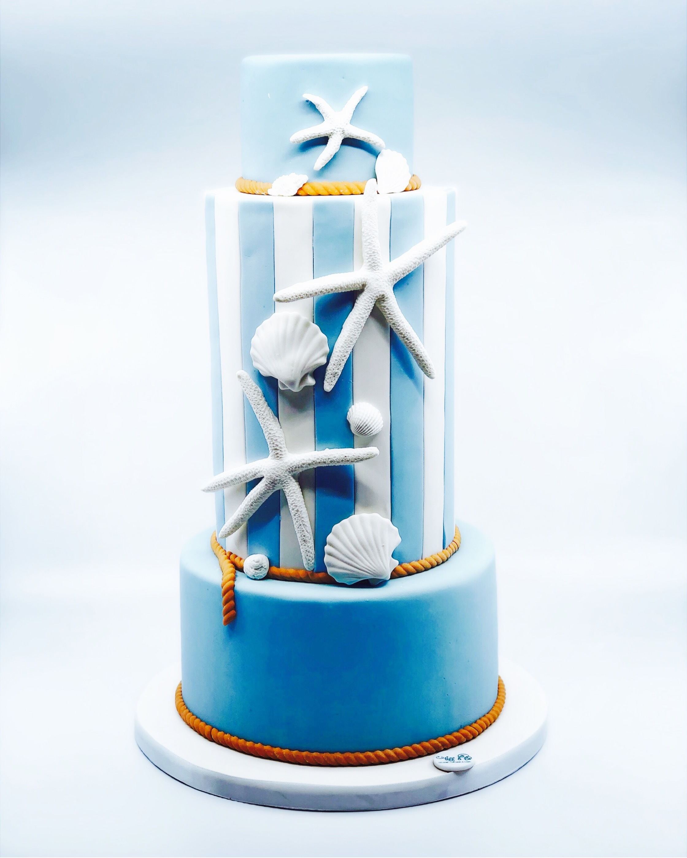 Blue and white seashell beach wedding cake