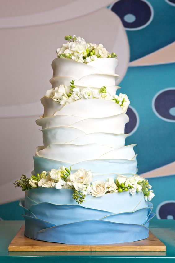 White and blue ombre ruffle wedding cake