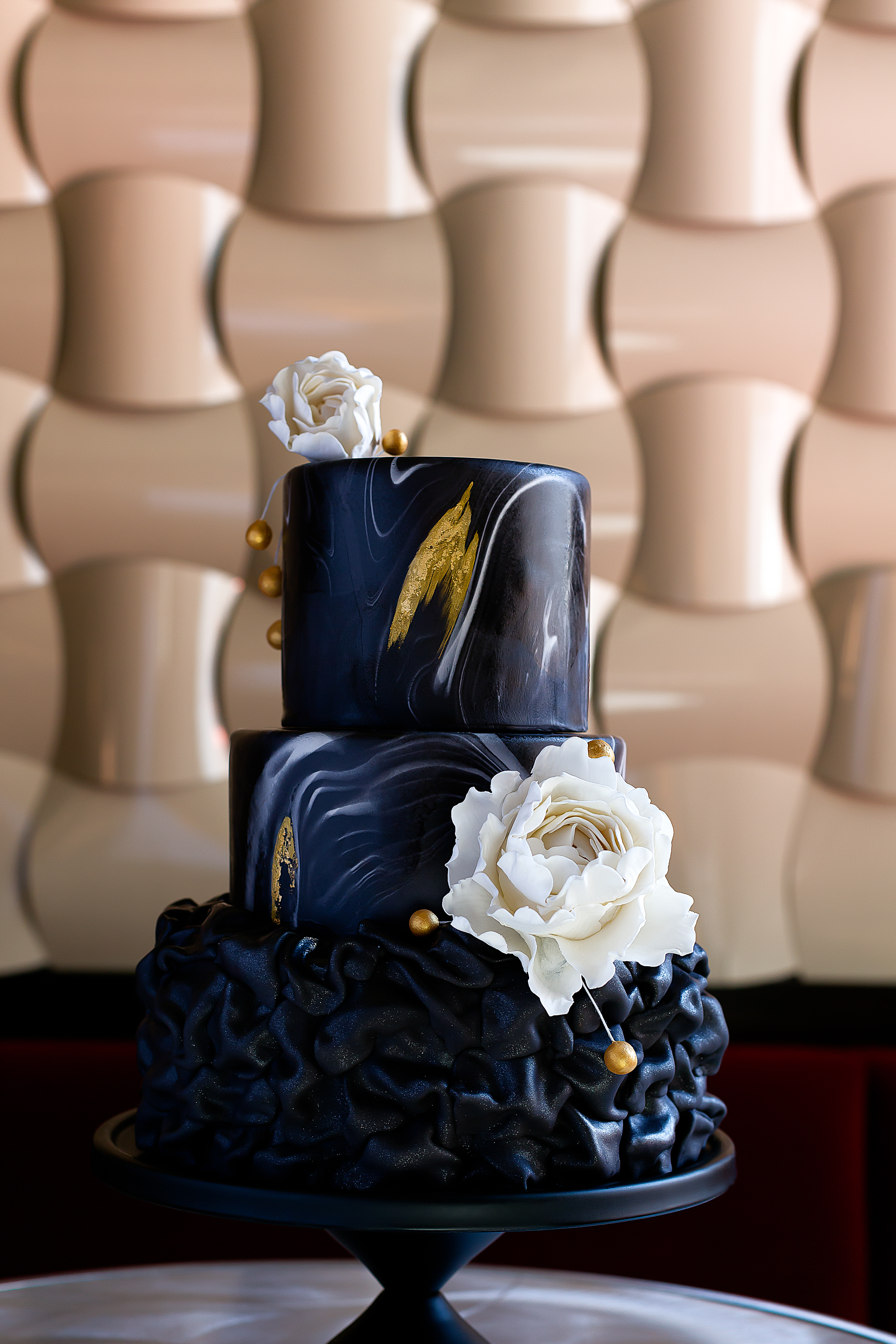 Dark blue with gold ruffle wedding cake