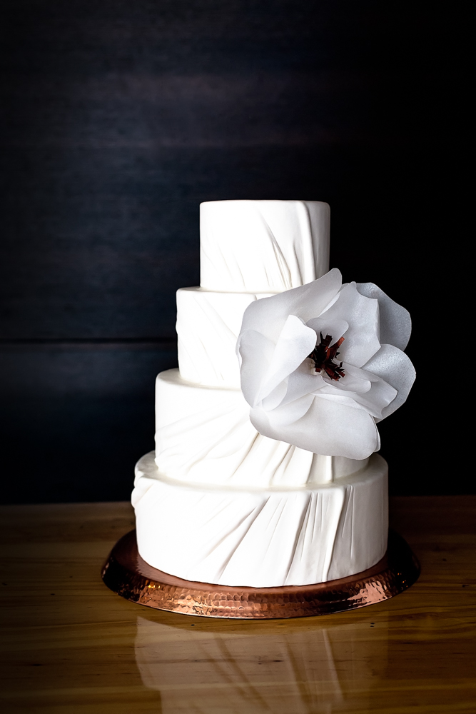 White wedding with large sugar flower