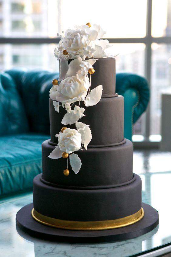 Black wedding cake with white sugar flowers
