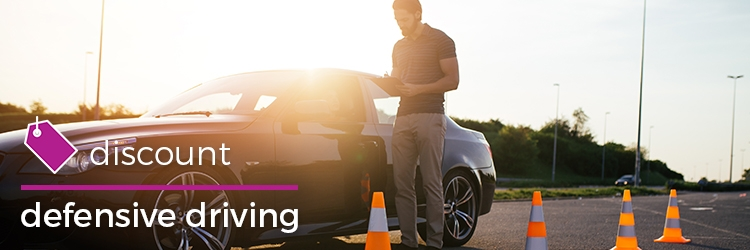 2018 08 07 Discounts Man Standing To Perfrom Driving Test Next To Car With Cones On Road