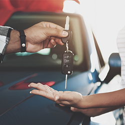 2019 04 08 blog woman getting handed keys new car teaser