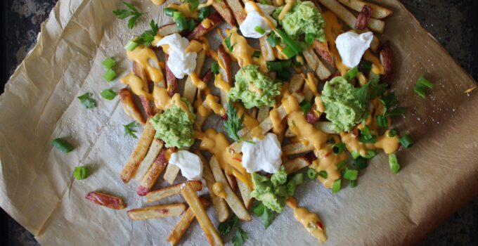 Baked Fries with Salsa Con Queso & Guacamole