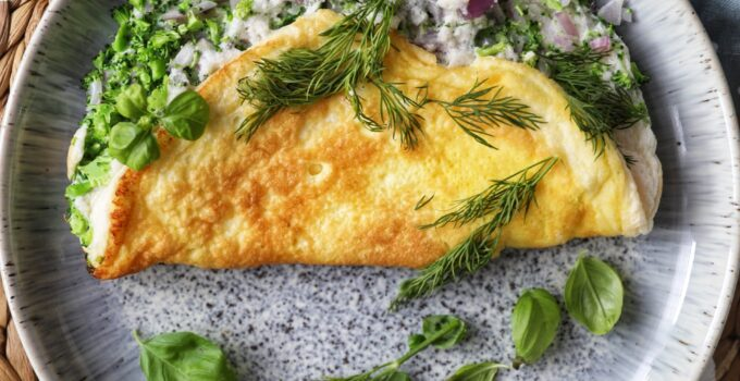 The Fluffiest Omelette with Broccoli, Red Onion, White Cheddar and Feta