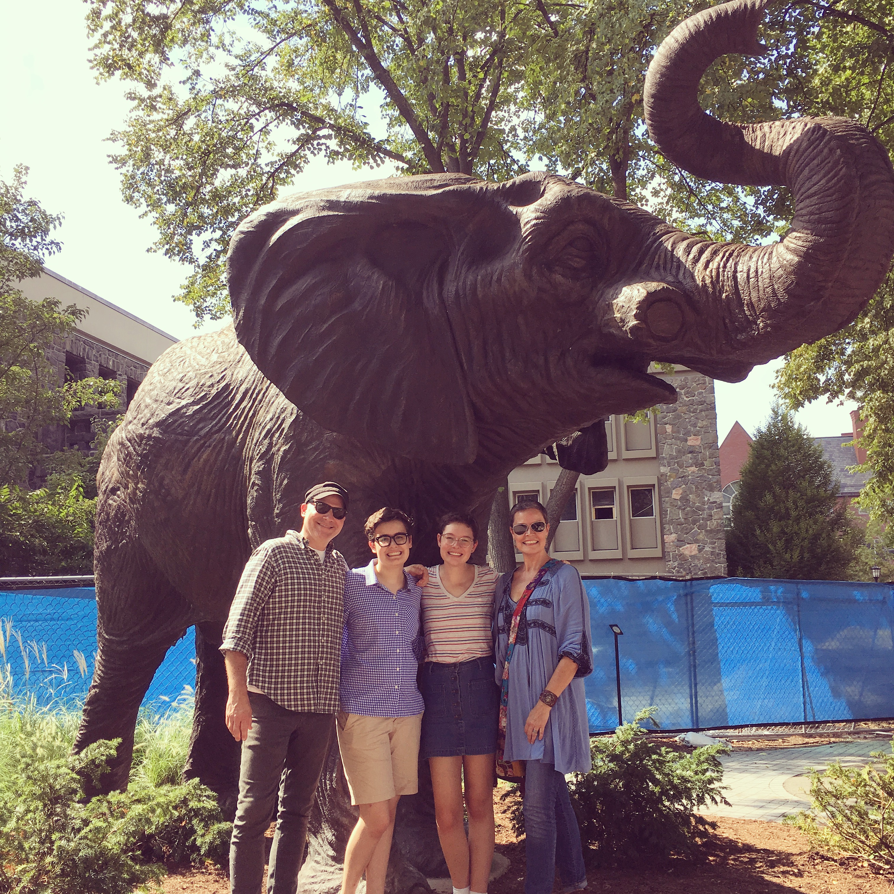 Photograph of 2019 League Champion Georgia Moore with her family at Tufts University.