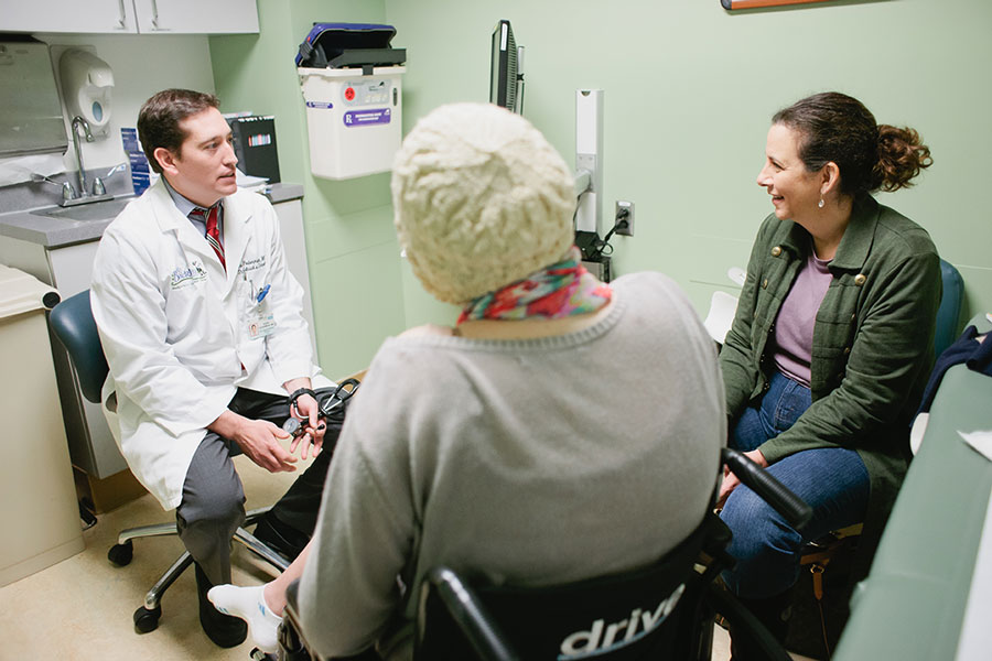 Dr. Federman meets with a patient.