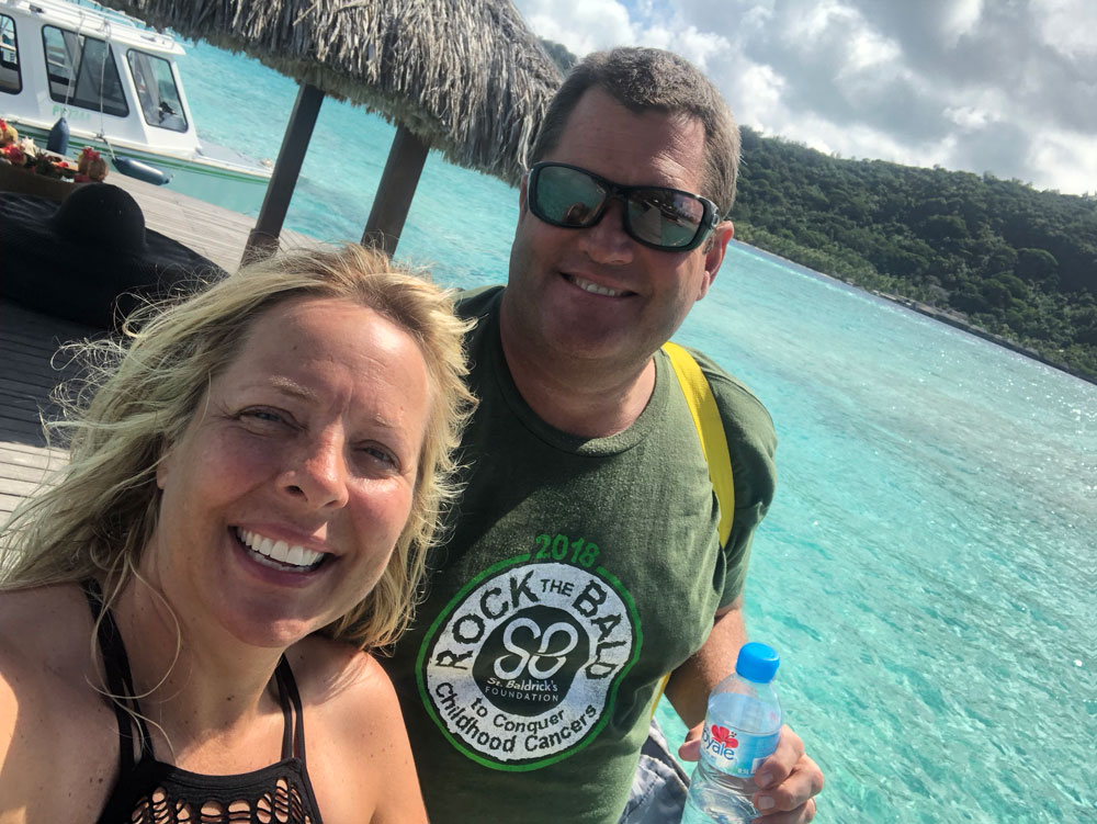 St. Baldrick's 2018 Sweepstakes winner in Tahiti with his wife.