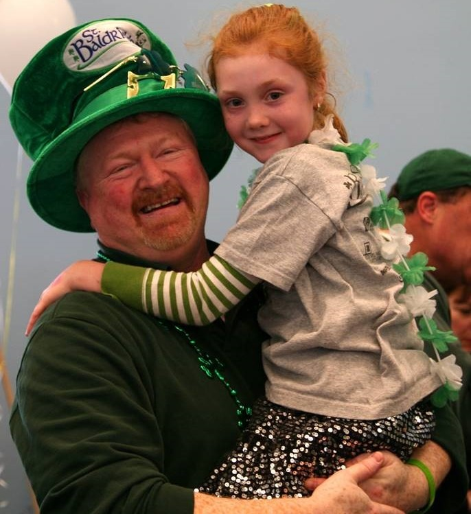 John and his daughter Shannon are photographed at a head-shaving event.