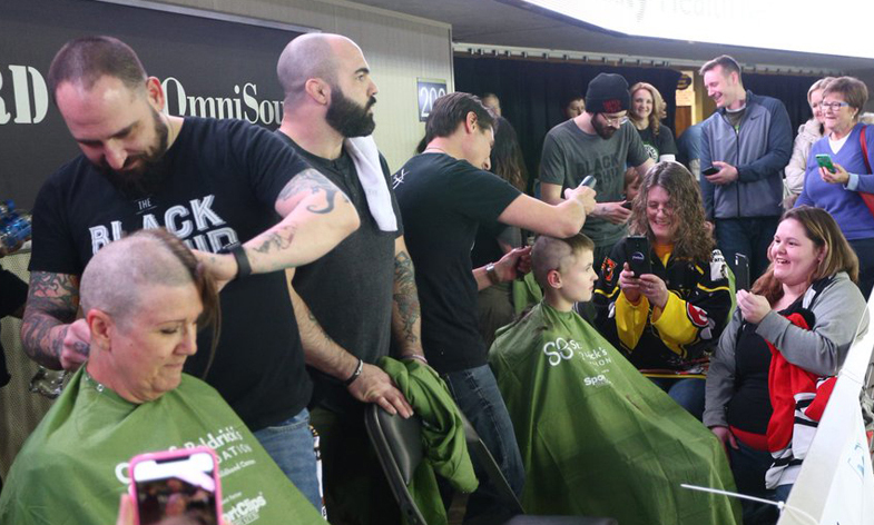 People have their heads shaved at a St. Baldrick's head-shaving fundraising event.
