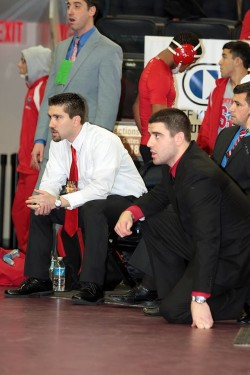 Stony Brook wrestling head coach Shaun Lally (left) sits with his team back in December at an event at Madison Square Garden.