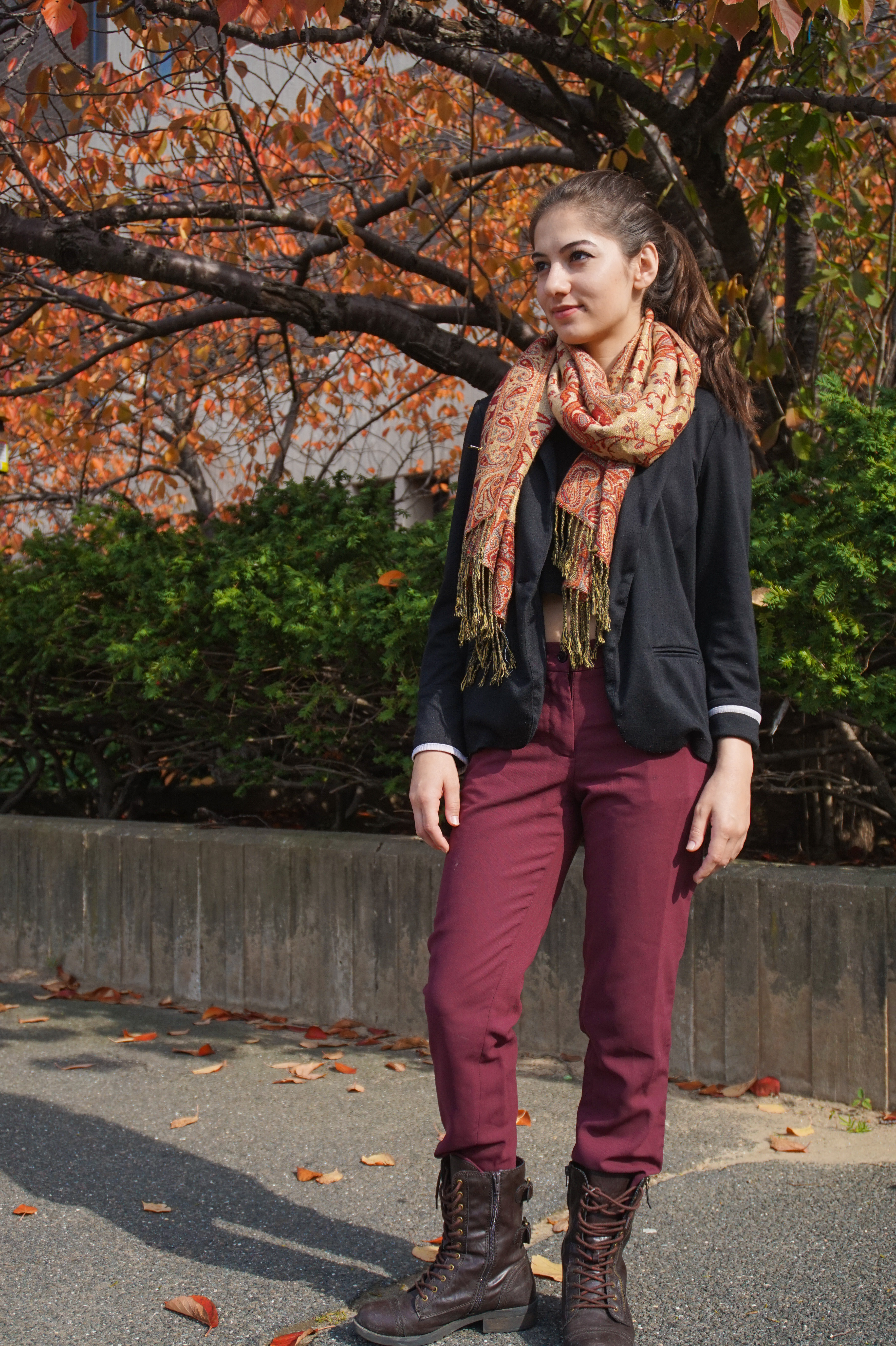 Rahila Babar, junior English major, takes a candid on Wednesday, Oct. 29, 2014. (HEATHER KHALIFA / THE STATESMAN)