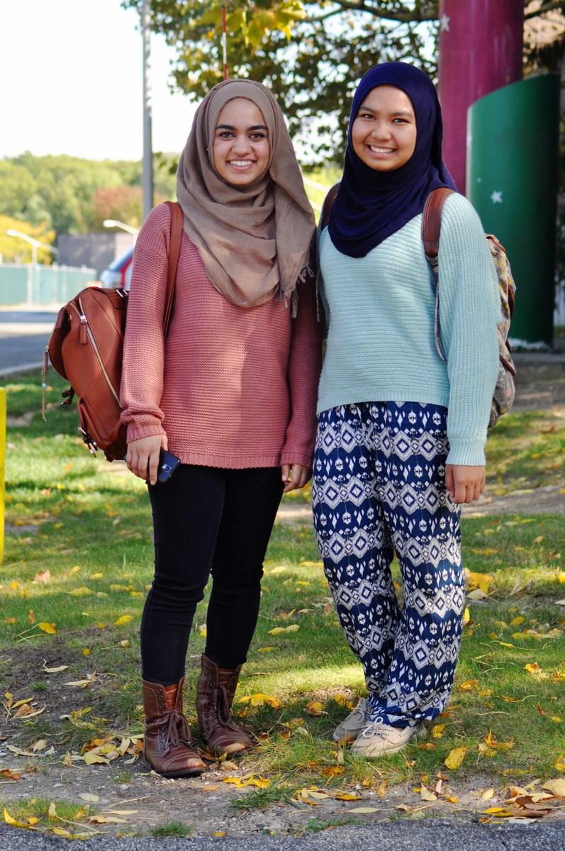 Ammarah Zaidi (left) and Azelea Tenriola (right) stop for a photo on Wednesday, Oct. 8, 2014. (SAHER JAFRI / THE STATESMAN)