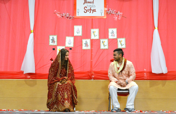 Students Sofya Pugach, left, and Ahmad Fordous on Saturday, Feb. 28, 2014 at the third annual Bengalis Unite Mock Wedding. The ceremony aimed to give Stony Brook University students a taste of Bengali wedding culture. CHRISTOPHER CAMERON / THE STATESMAN