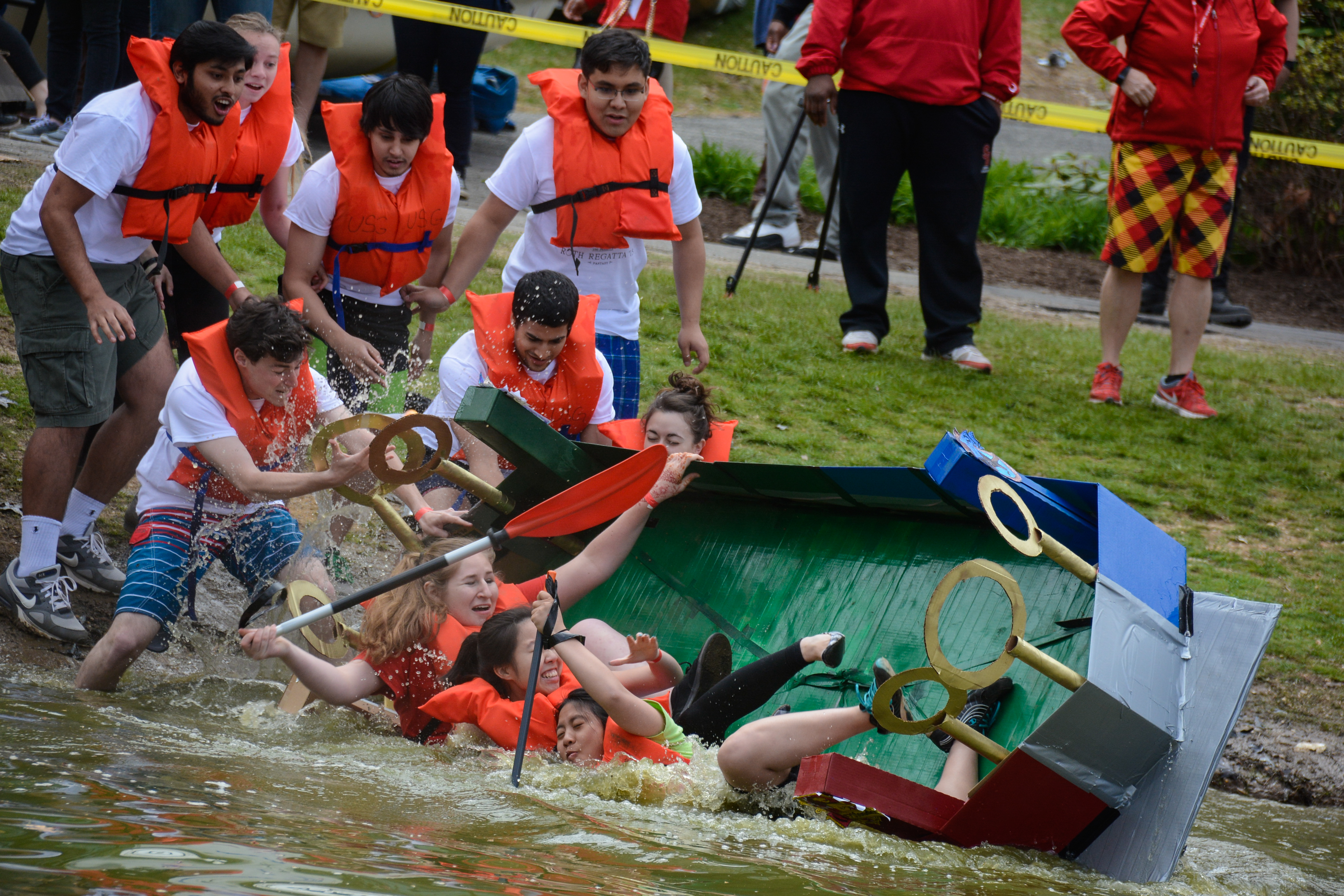 Stony Brook students capsizing on launch during the spring 2015 Roth Regatta. A report released in August revealed that potentially toxic cyanobacteria was present in Roth Pond. HEATHER KHALIFA / THE STATESMAN