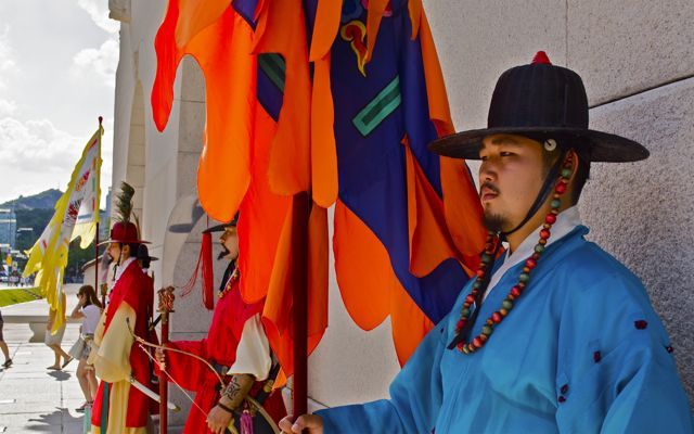 A royal standard bearer standing guard at the Gwanghwamun gate, the main entrance into the Gyeongbok Palace and the threshold between modern Seoul and the historical recreation. CHRISTOPHER CAMERON / THE STATESMAN