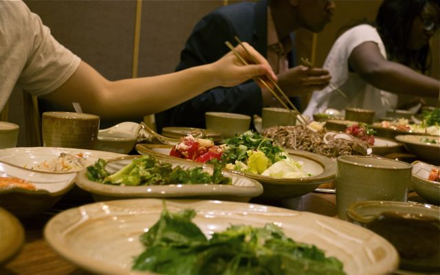 A typical Korean dinner spread. Korean dining usually serves all portions of the meal in separate bowls that are shared among diners. CHRISTOPHER CAMERON / THE STATESMAN