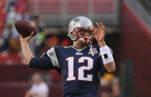 Tom Brady, above, arguably the greatest NFL quarterback of all time, has led the Patriots since 2001. Since then, the organization has seen four championship wins and two major scandals.