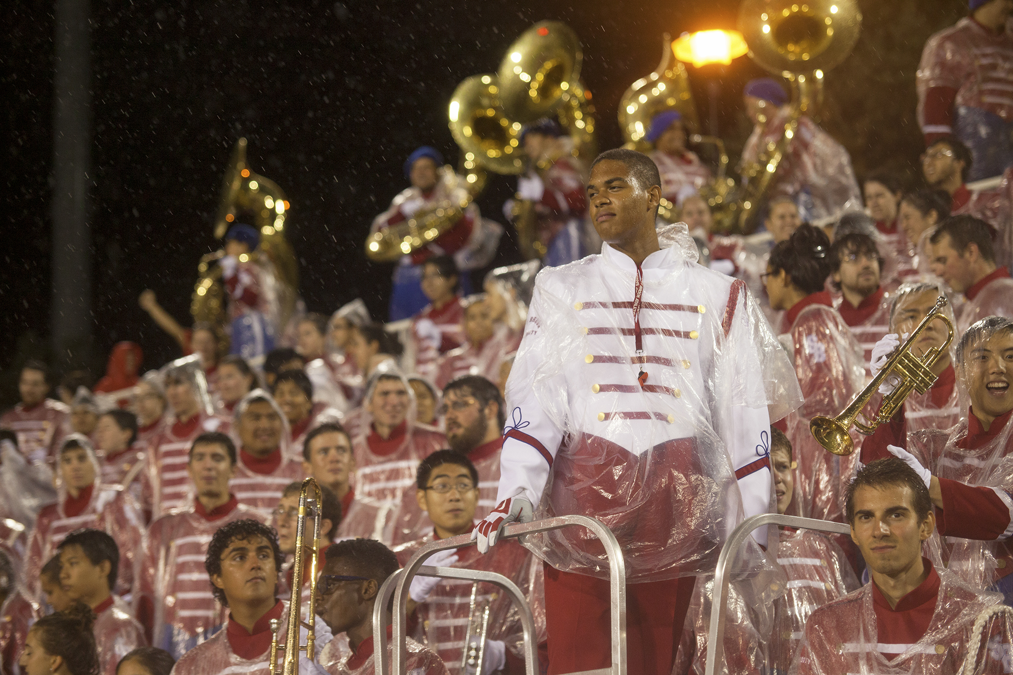 Assistant Drum Major Quamel Francis (above, center-right) toughing out the torrential rain during the football game against the Central Connecticut Blue Devils on Saturday. CHRISTOPHER CAMERON/THE STATESMAN