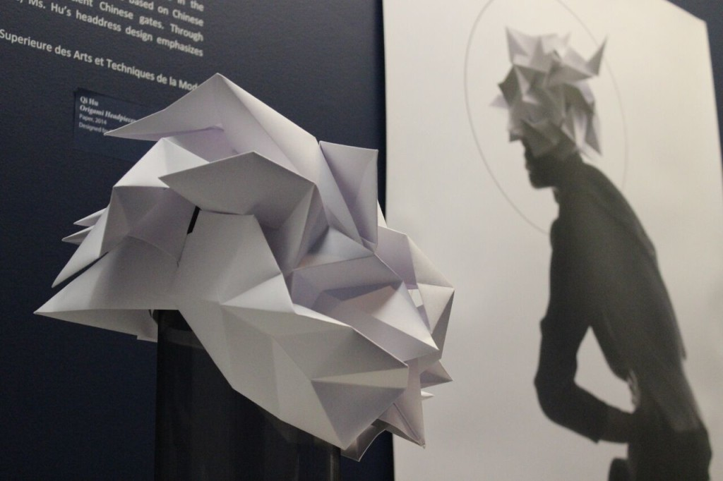 Fashion designer Qi Hu created this paper headdress inspired by origami techniques and Asian culture. TAYLOR HA/THE STATESMAN