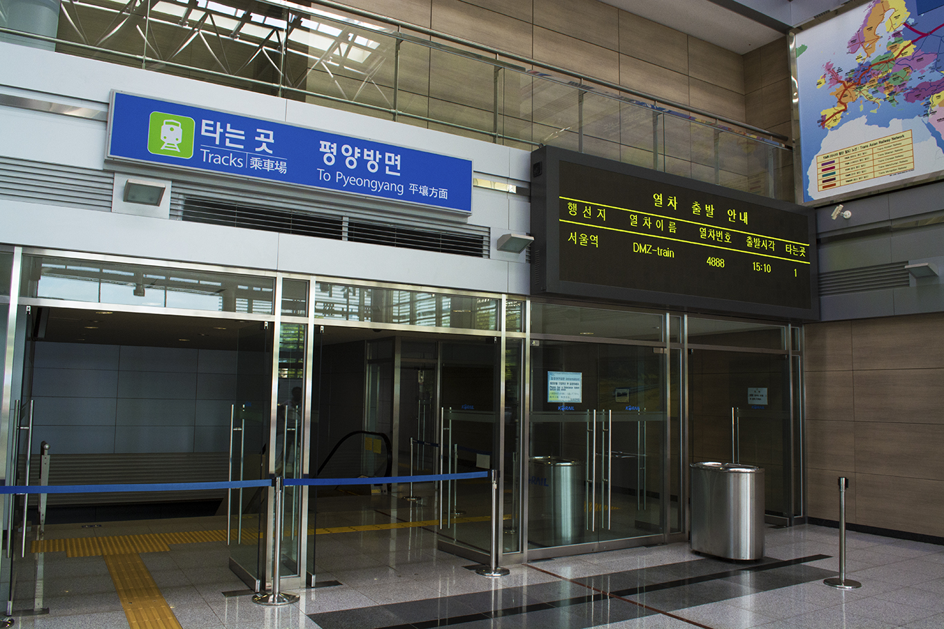 The departure terminal in Dorasan station inside the Korean DMZ. The banner for the train route to Pyongyang still stands despite its cancellation. Tourists can visit the train platform by purchasing a