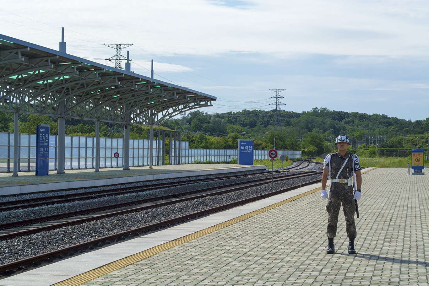 A South Korean soldier guards the northern side of the Dorasan station platform. The hangeul characters on his helmet identify him as military police. (CHRISTOPHER CAMERON/THE STATESMAN)