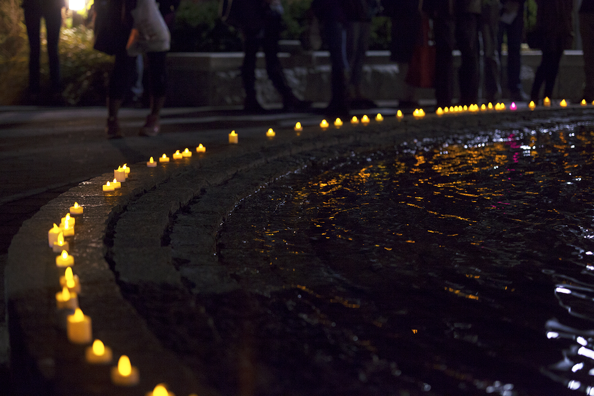 The Undergraduate Student Government organized a candlelight vigil on Nov. 17, 2015 for those who suffered from attacks in Paris, Beirut and other places around the world. CHRISTOPHER CAMERON/THE STATESMAN