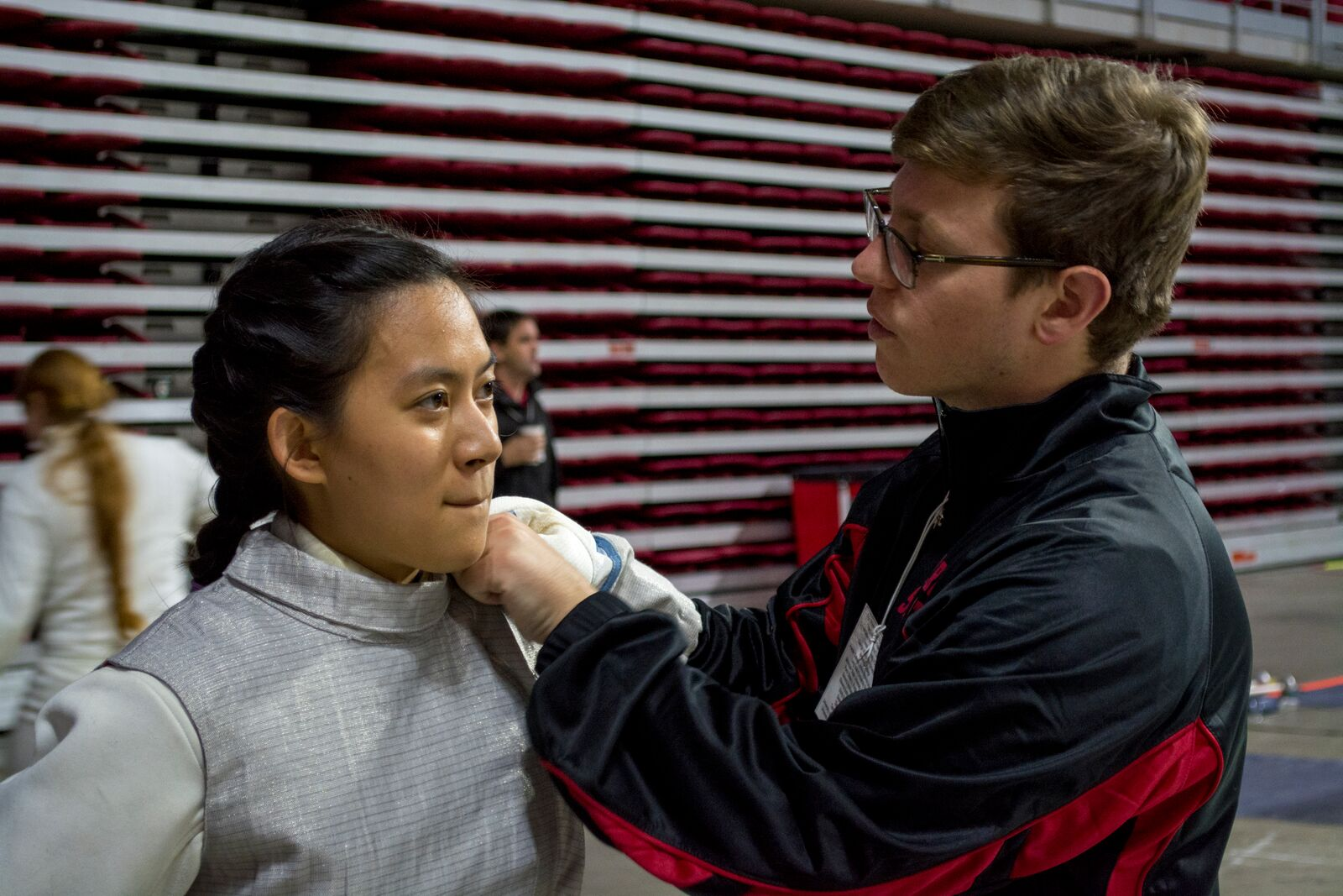 Stony Brook Fencing Club Coach Jeremy Allen (above, right) helps  sophomore foil fencer and first time competitor Sydney Jaw prepare for her first bout at the Temple Open. Jaw would go on to place 69th out of 81 in the Women's Foil division. CHRISTOPHER CAMERON/THE STATESMAN