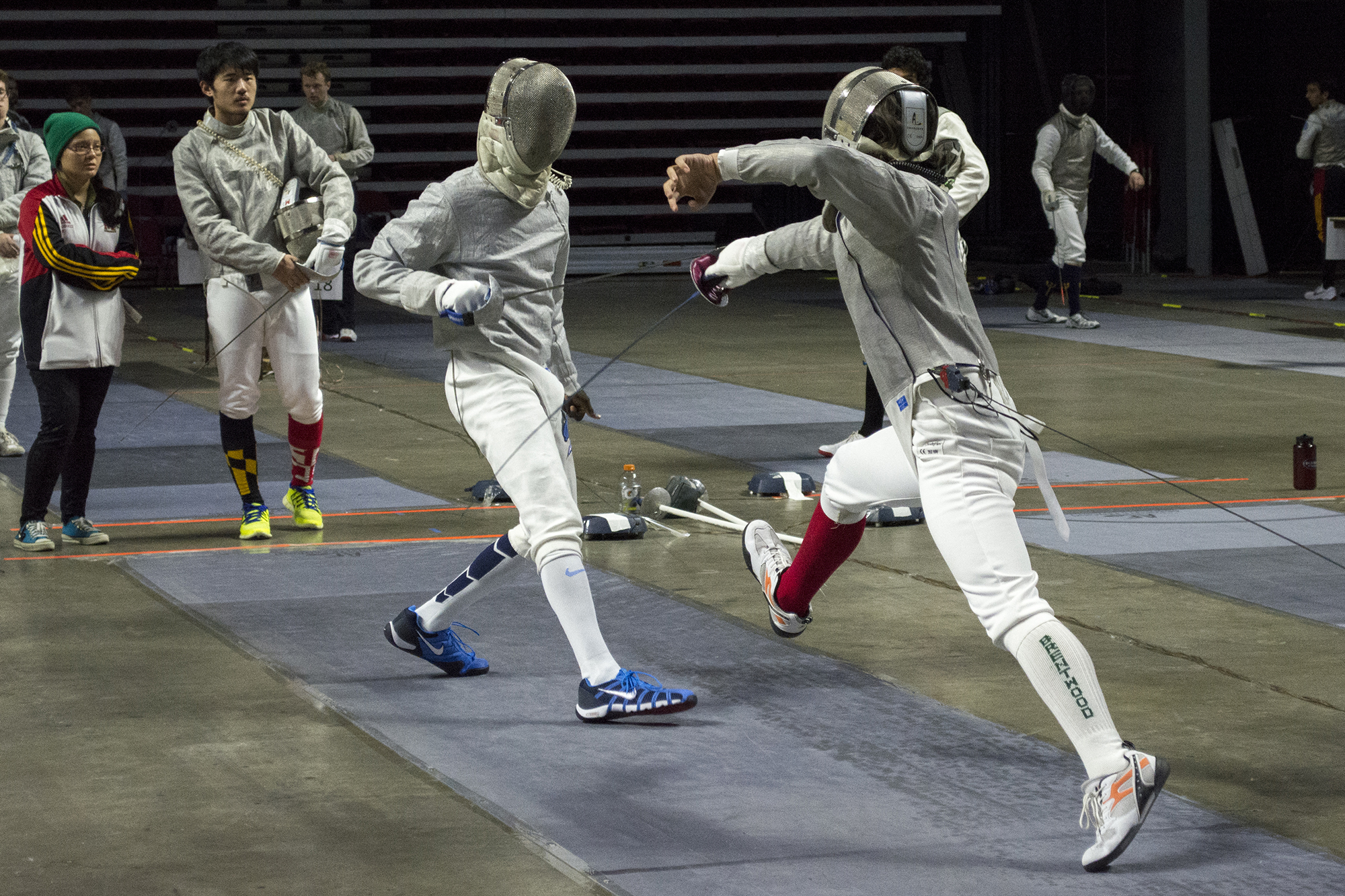 Stony Brook sophomore sabre fencer Braulio Trejo (above, right) competes in the second round of pools at the Temple Open. Trejo would go on to place 52nd out of 72 in the Men's Sabre division. CHRISTOPHER CAMERON/THE STATESMAN