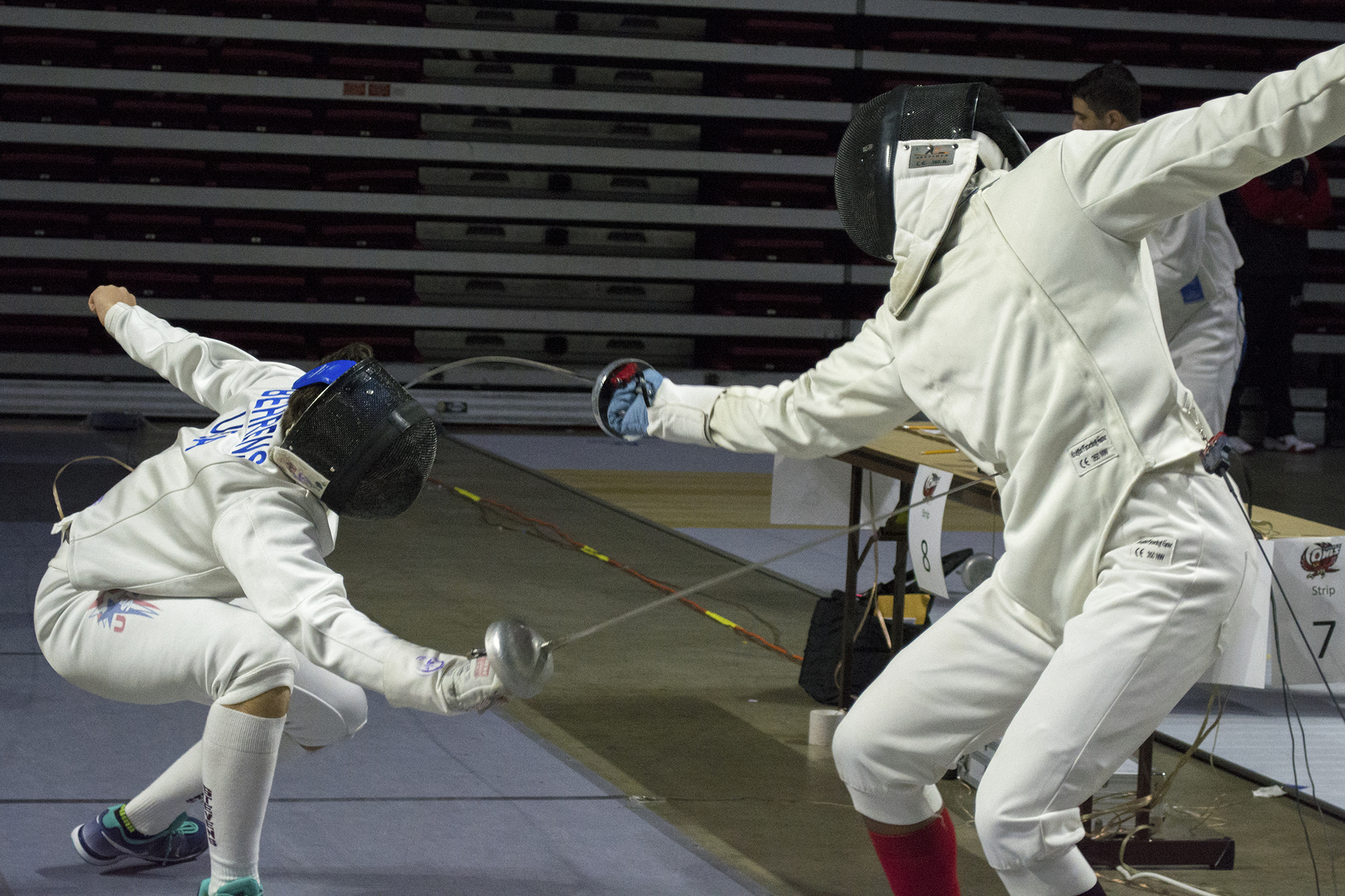 Stony Brook junior épée fencer Avery Holmes (above, right) competes in his direct elimination match with Stevens épée fencer Leonard Behrens. Holmes would place 58th out of 80 for his first competition with Stony Brook. CHRISTOPHER CAMERON/THE STATESMAN