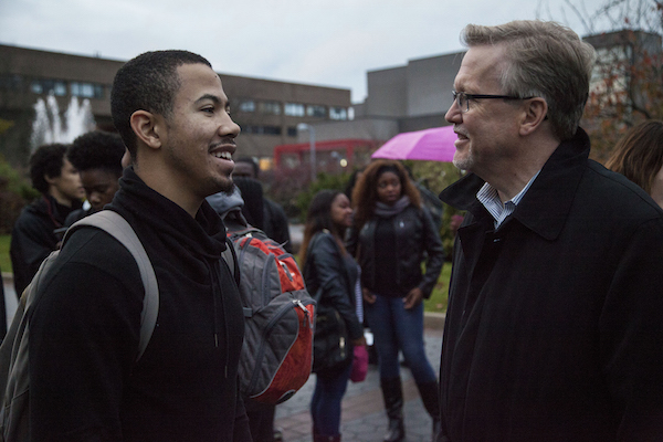 Stony Brook University Dean of Students Timothy Ecklund speaks with a demonstrator. KELLY ZEGERS/THE STATESMAN