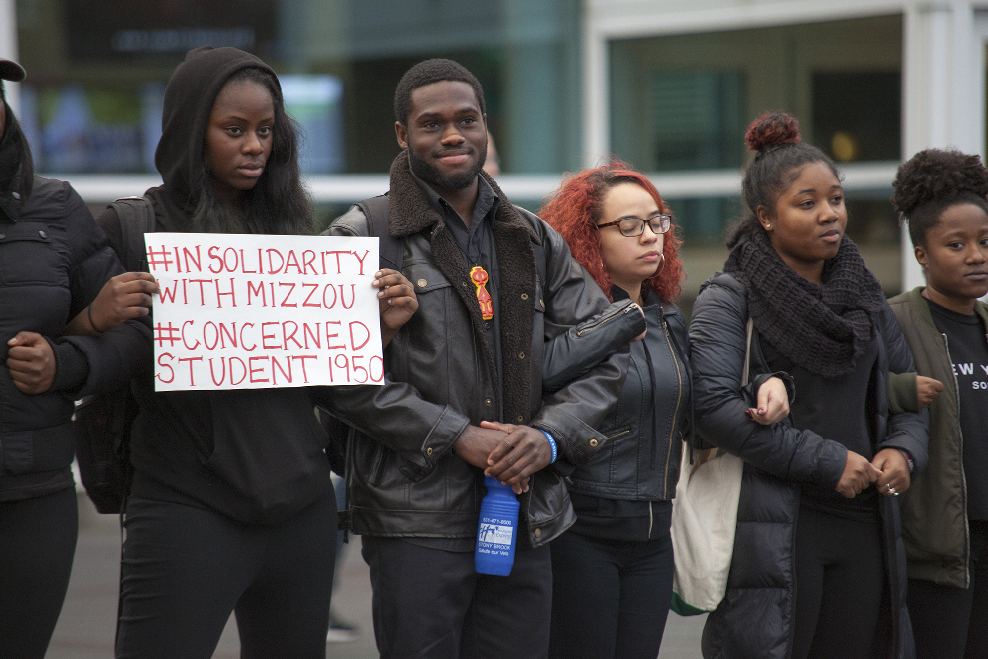 Stony Brook students gather outside of the Student Activities Center to begin their demonstration showing solidarity with the black community at the University of Missouri. CHRISTOPHER CAMERON/THE STATESMAN
