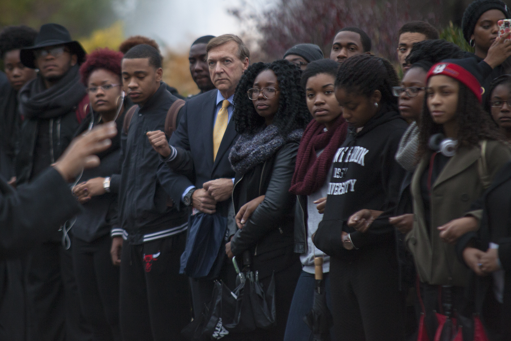 Stony Brook University President Samuel L. Stanley Jr. participates in a demonstration with Stony Brook students on Nov. 12, 2015. CHRISTOPHER CAMERON/THE STATESMAN