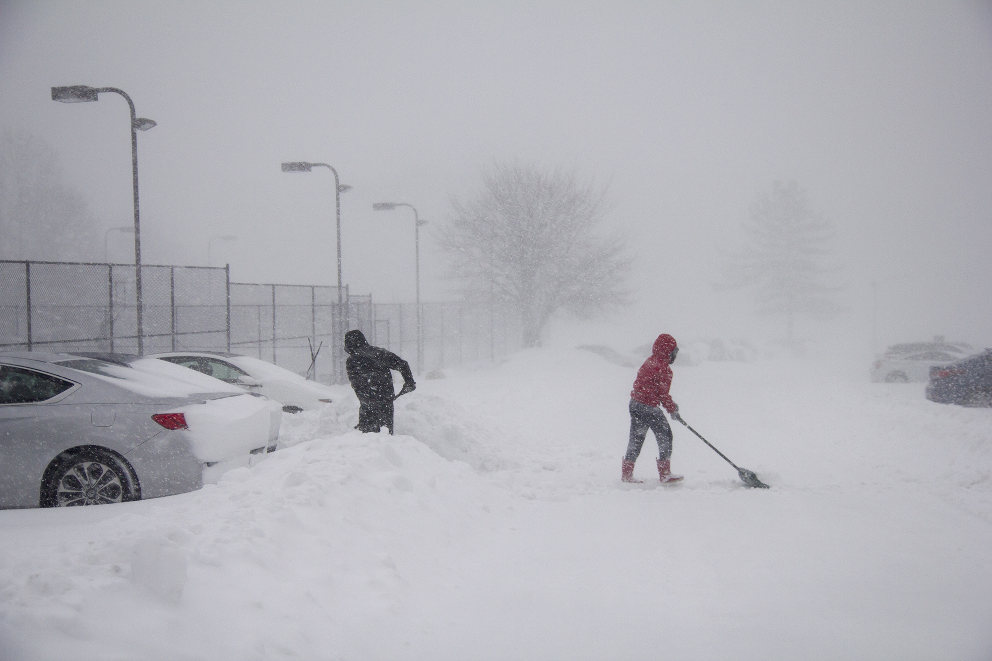 Maria Zambuto (right) and Sylvester Buccat (left) work to shovel out their car near Hand College. ERIC SCHMID/THE STATESMAN