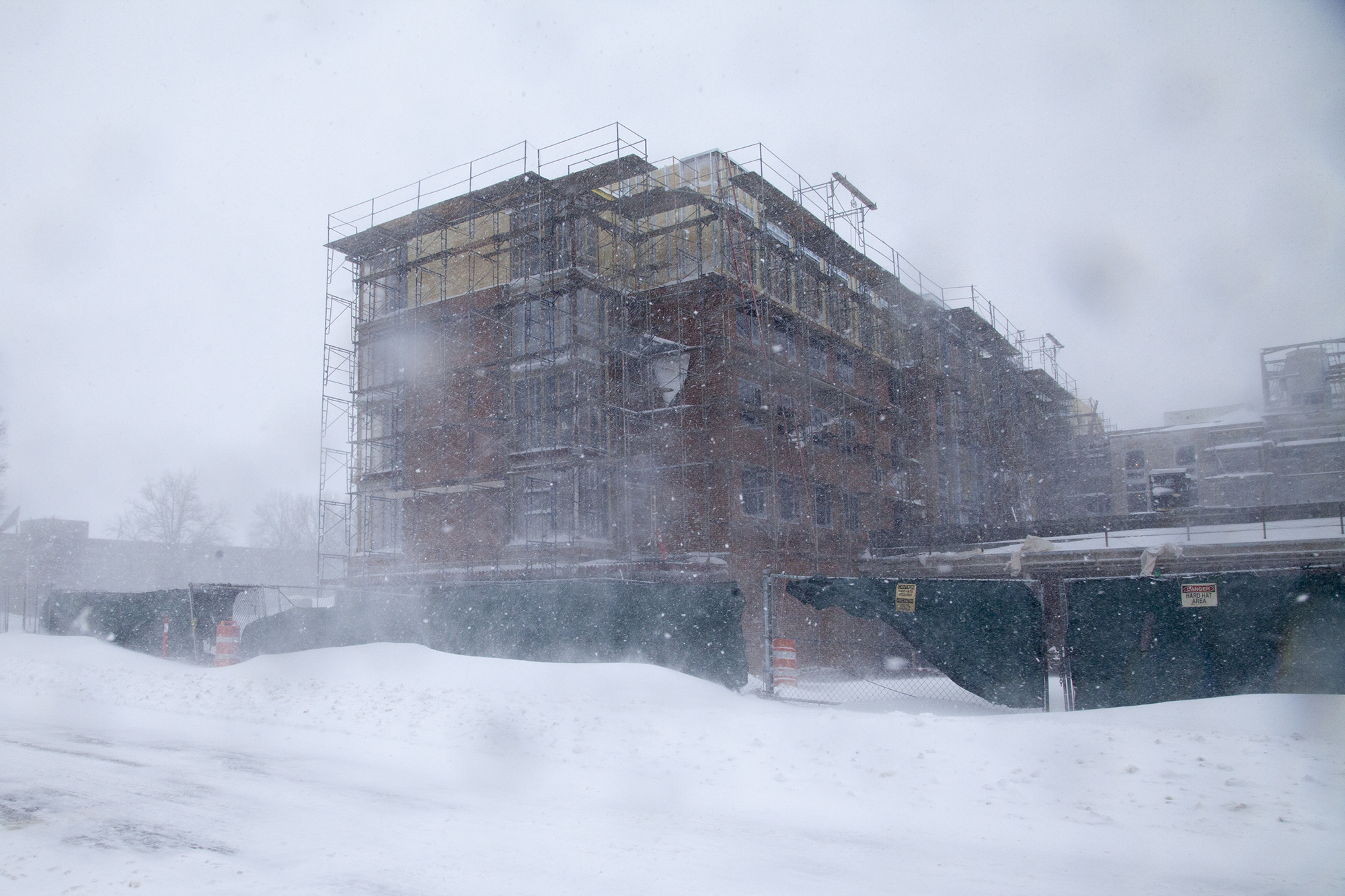 The new residence hall currently under construction by the Student Union at Stony Brook University during Winter Storm Jonas on Saturday, Jan. 23. CHRISTOPHER CAMERON/THE STATESMAN