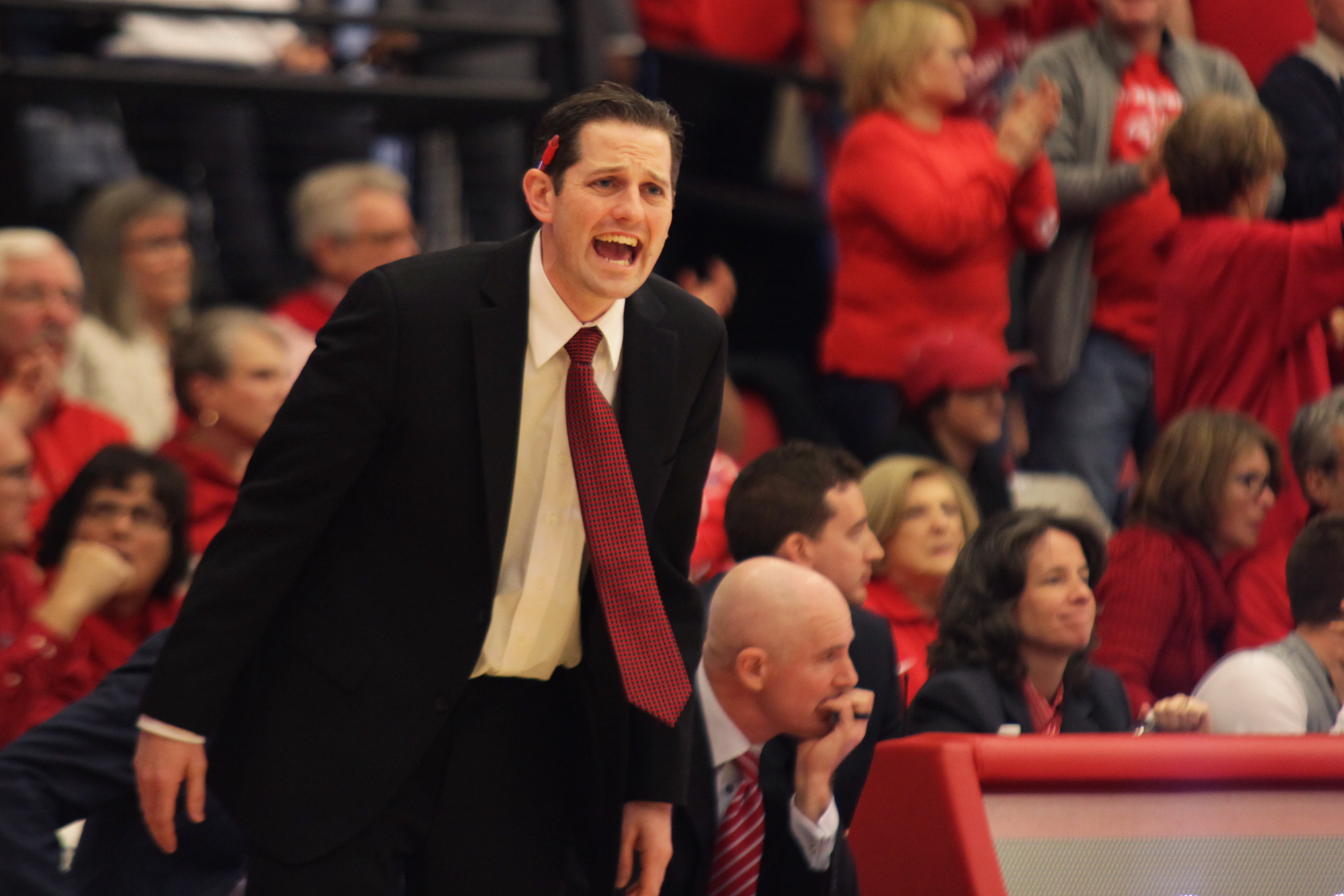 Stony Brook Men's Basketball Assistant Coach Dan Rickard shouts commands from the sideline as the Seawolves pushes back the Catamounts' lead during their championship game. CHRISTOPHER CAMERON/THE STATESMAN