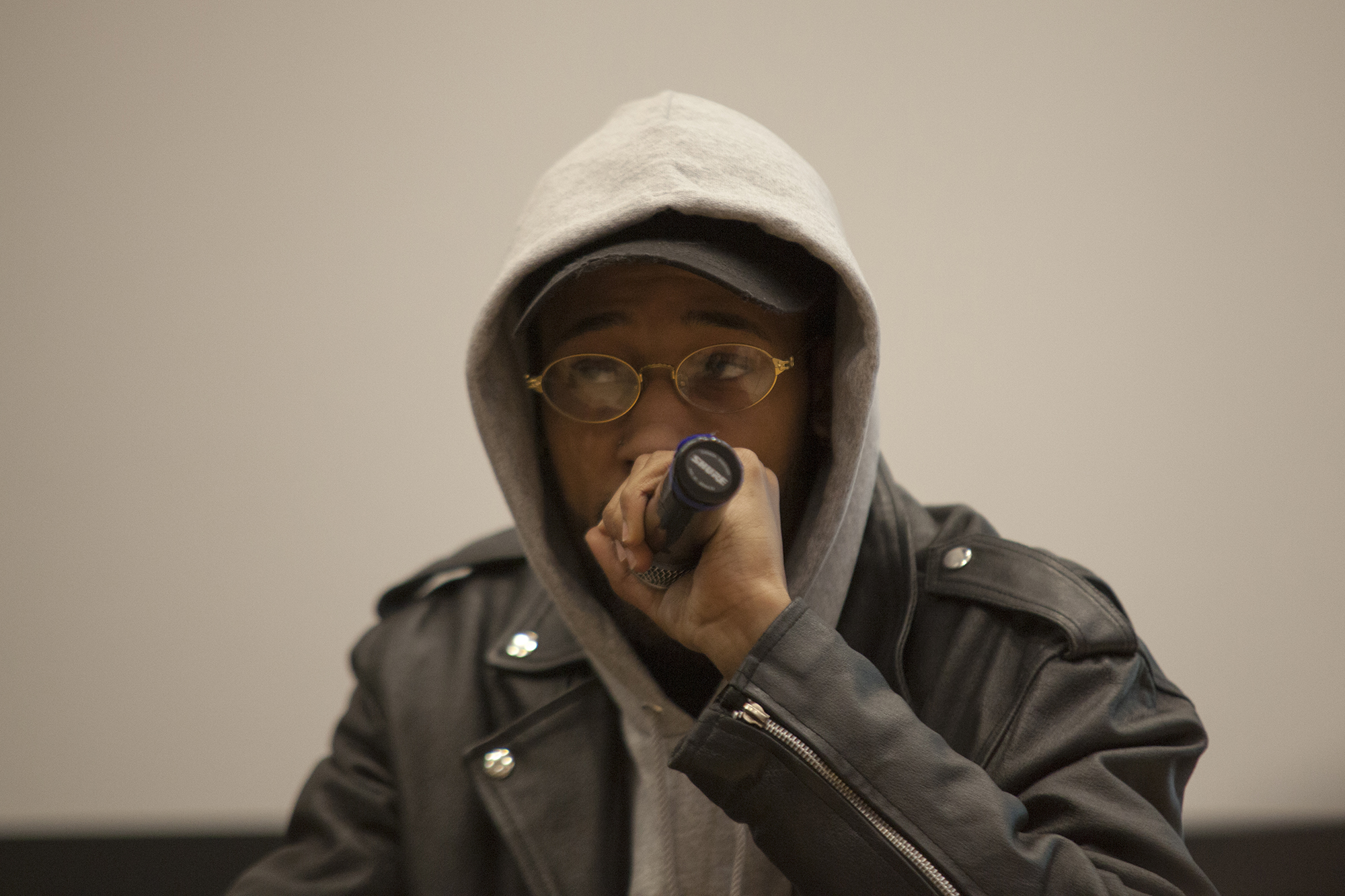 Dondre Macfarland rapped for the crowd during his performance on Wednesday. <em>ERIC SCHMID/THE STATESMAN</em>