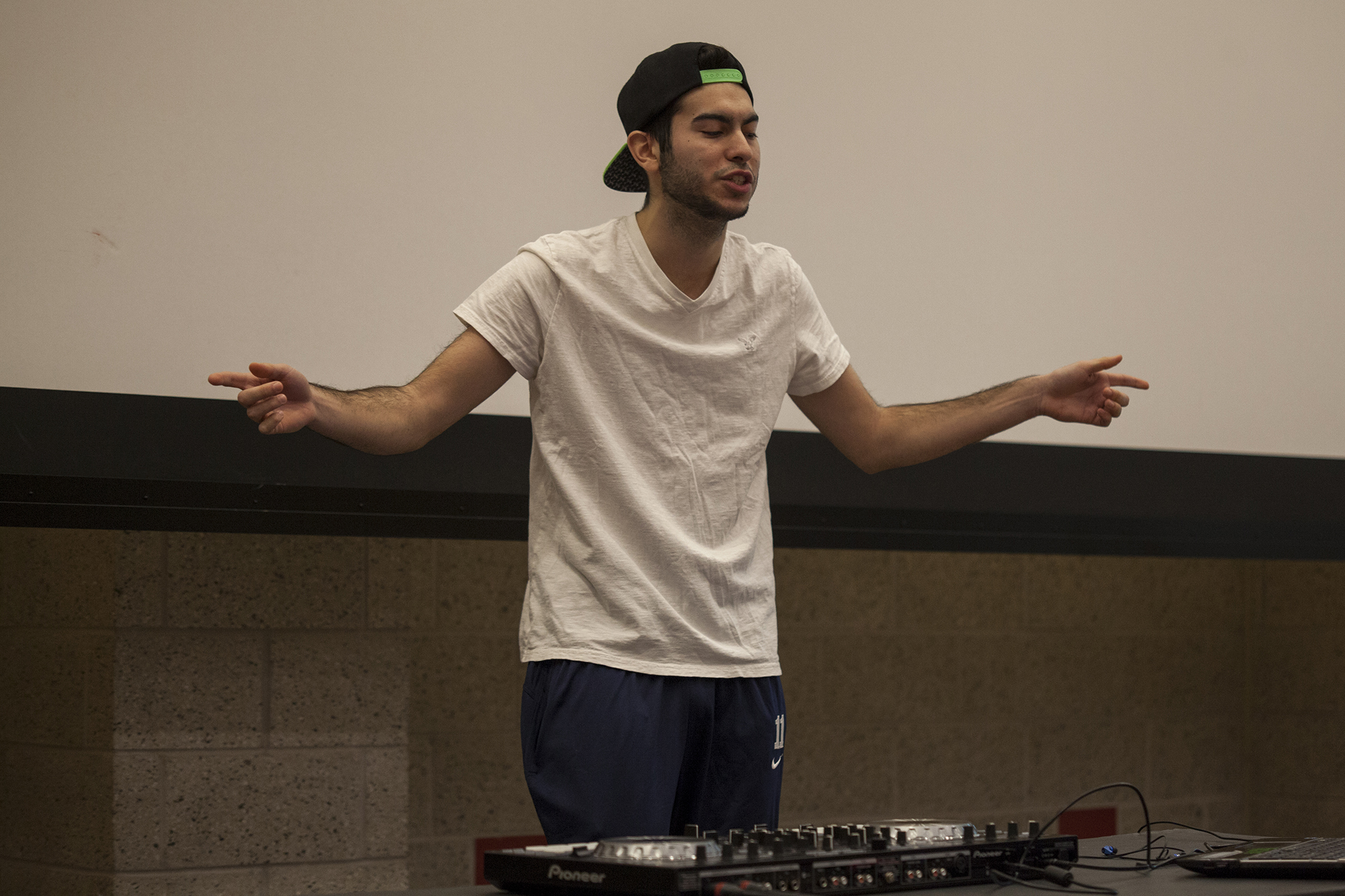 DJ Fr3or took a break from his performance to sing and dance along with his mix. <em>ERIC SCHMID/THE STATESMAN</em>