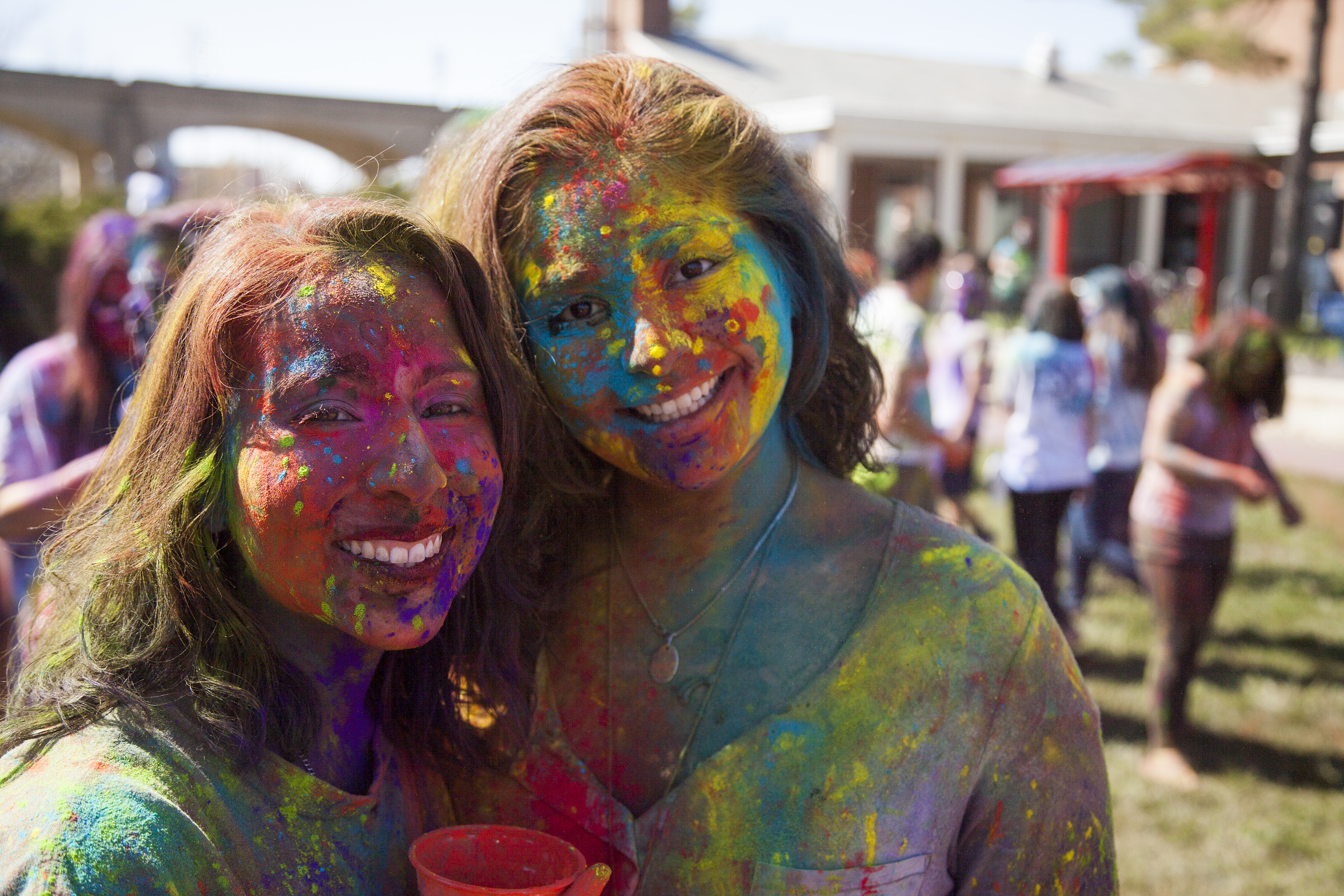 Tatiana Guerra, left and Diana Mohibi took a break from studying to attend Holi in the Mendelsohn Quad pit. ERIC SCHMID/THE STATESMAN