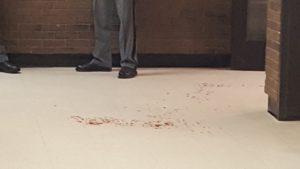 Blood splatters on the floor of the library. SKYLER GILBERT/THE STATESMAN