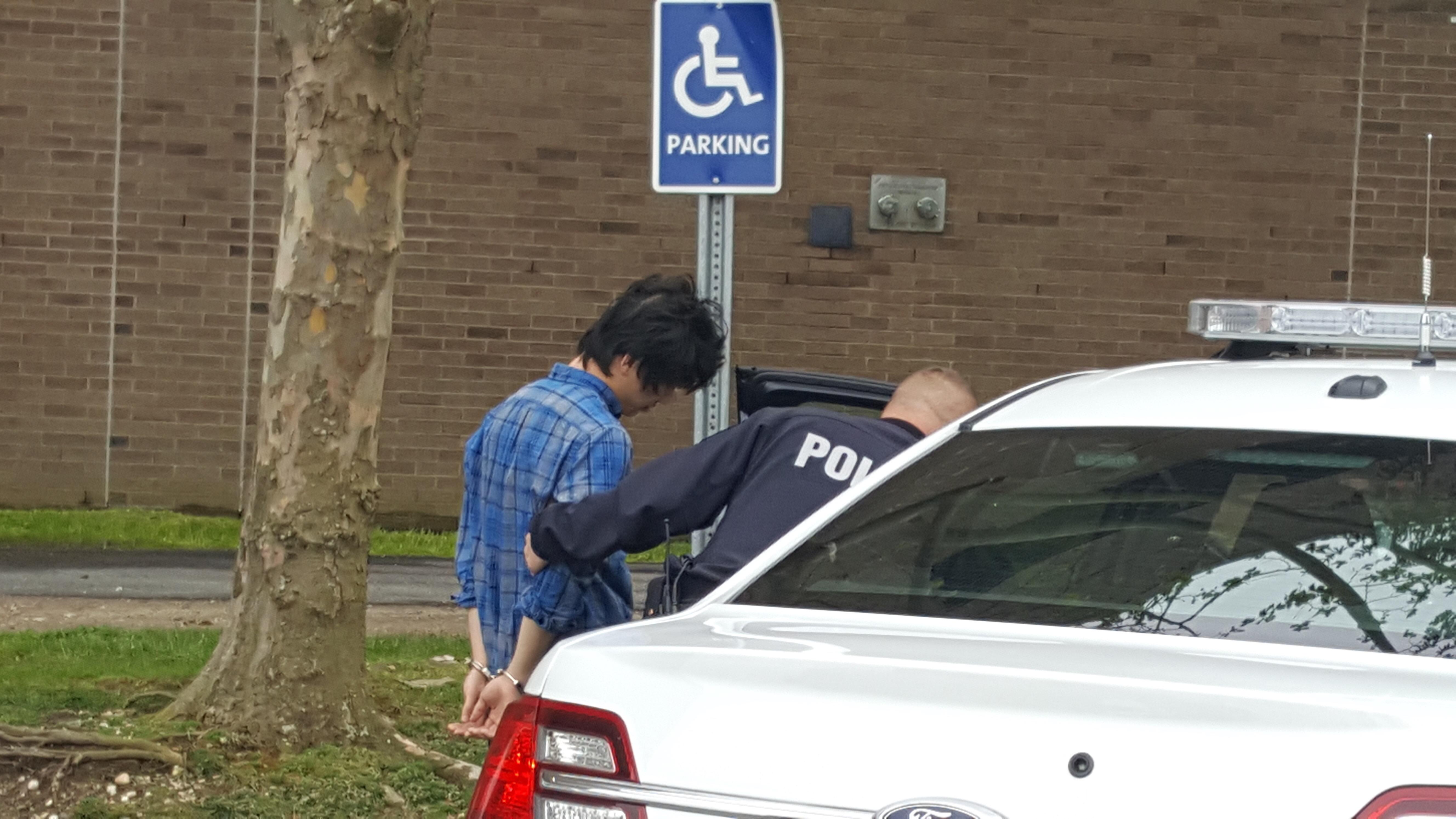An individual taken into custody outside of the Melville Library. SKYLER GILBERT/THE STATESMAN
