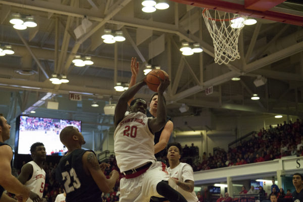 Jameel Warney (No. 20) attempts a layup in a 59-58 win against New Hampshire on Feb. 14, 2016 in Island Federal Credit Union Arena. ERIC SCHMID/STATESMAN FILE