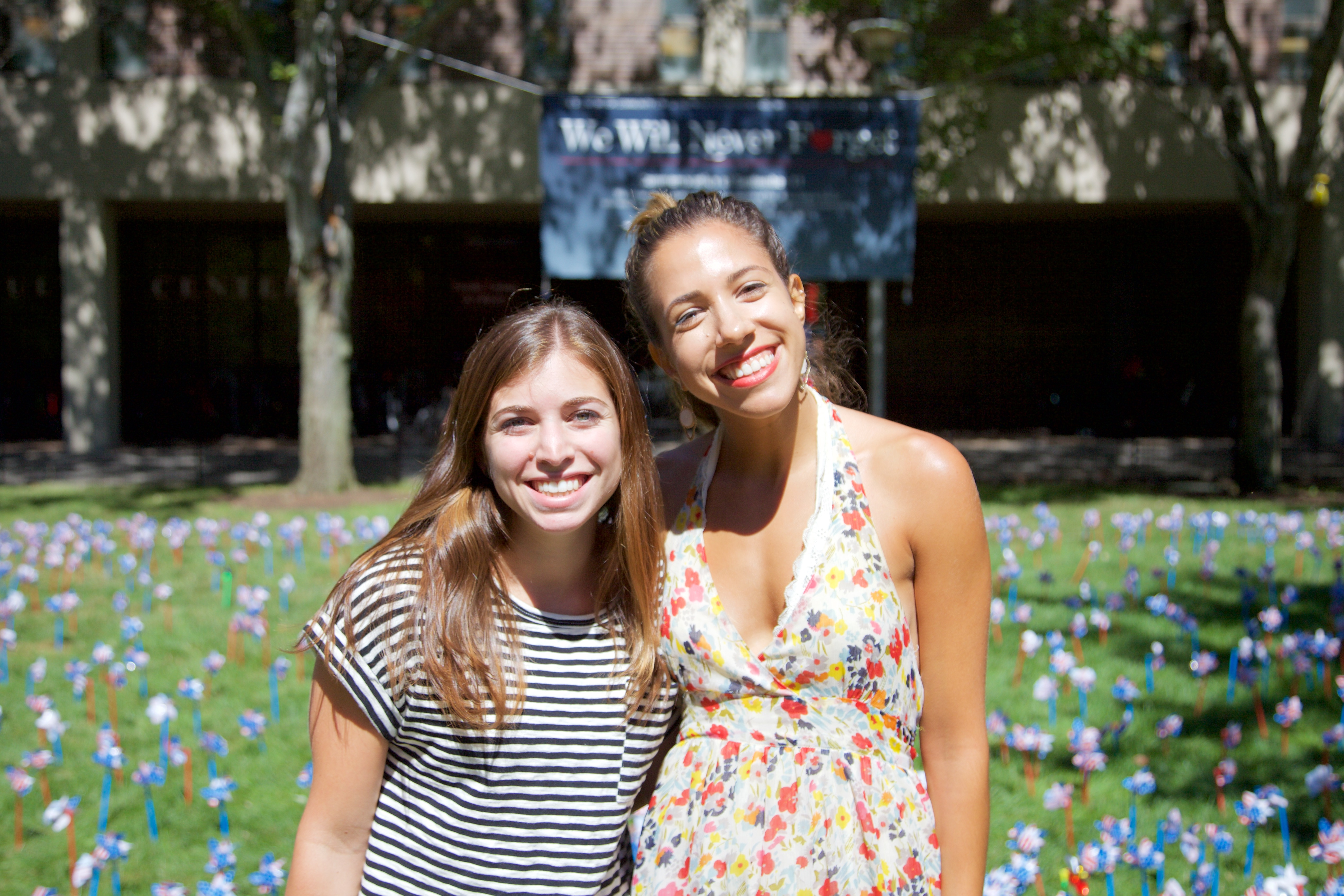 "Aline Szenczy, a research coordinator at the developmental stress and prevention lab, left, and Allison Lazzaro, a master's psychology student, right, were both appreciative of the pinwheel ceremony. ""I didn't expect anything to go on today, so it's really nice that even though the anniversary was yesterday, it's still being remembered as a campus,"" Lazzaro said. ANGELICA CARPENTER/THE STATESMAN"