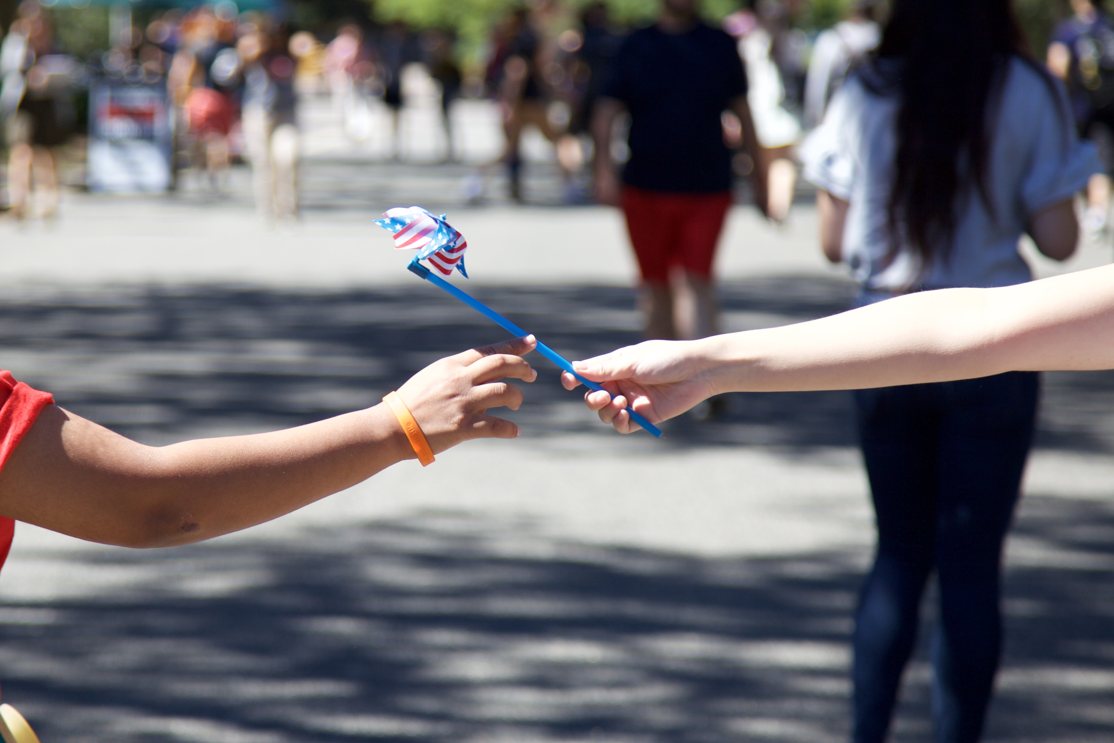 Students are handed American flag pinwheels to commemorate the men and women who died in the 9/11 terror attacks. ARACELY JIMENEZ/THE STATESMAN