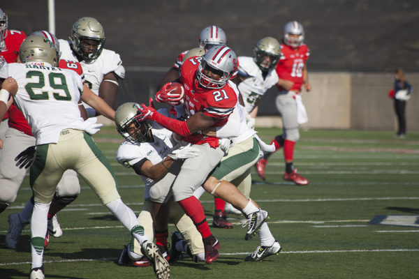 Redshirt junior running back Stacey Bedell breaks through a tackle. The Seawolves fell to the Tribe ARACELY JIMENEZ/THE STATESMAN