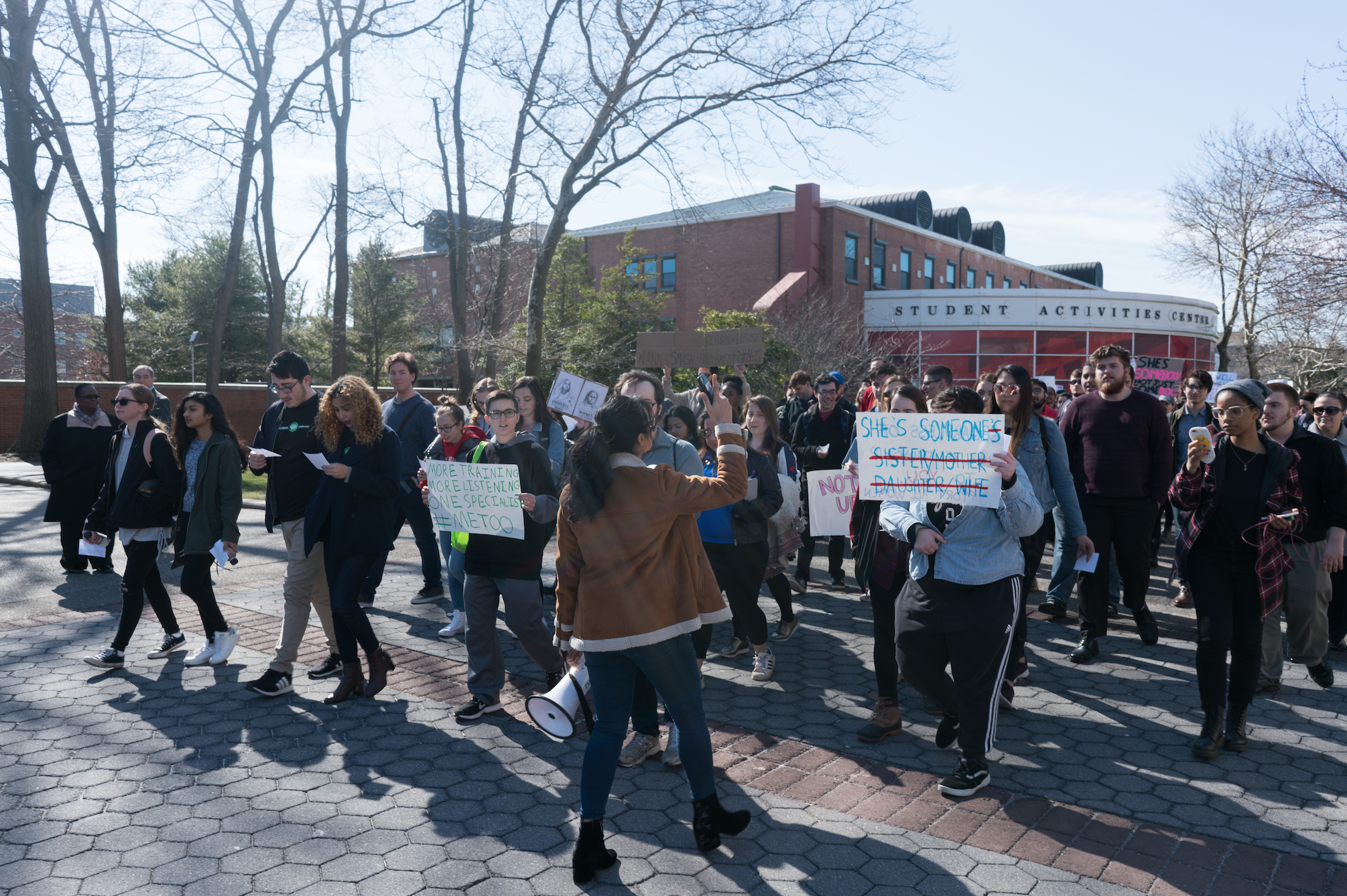 Students marched through the Academic Mall in support of the #MeToo movement. <em>GARY GHAYRAT/THE STATESMAN</em>