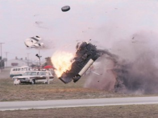 The Ford GT40 of Bob McLean on fire after hitting a power pole shearing it off at the base. The car's fuel tanks were fully loaded after a recent pit stop and the car hit the unprotected pole broadside where the fuel tanks were located. (Bill Stowe photo)