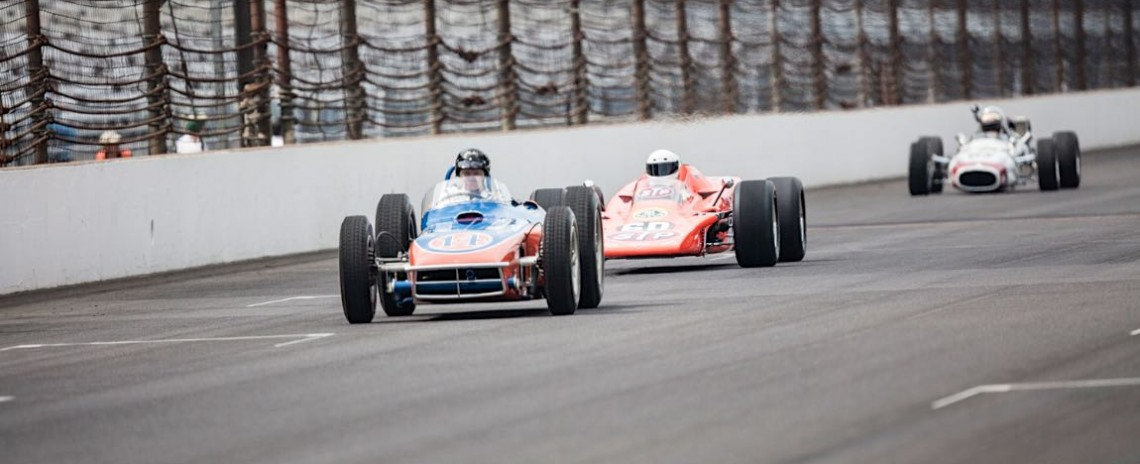 The famous Lotus Turbine car (60) jockeys with other historic oval cars on Saturday afternoon