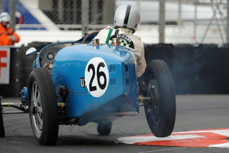 Paul-Emile Bessade lifts a wheel in the 1934 Bugatti Type 51